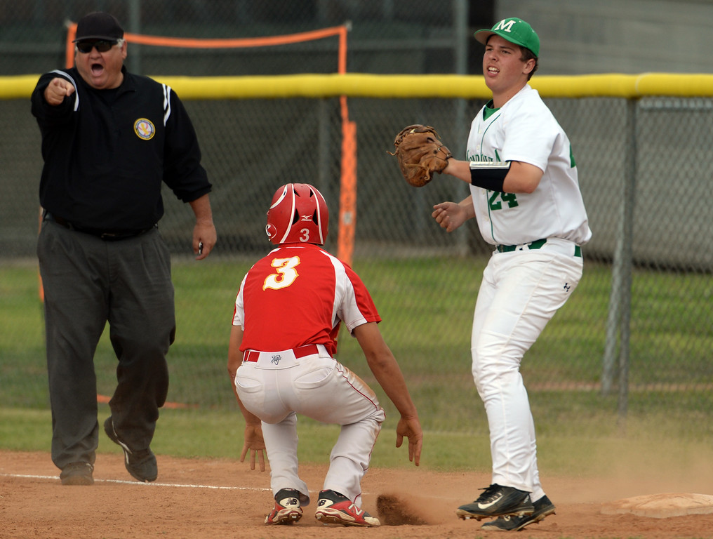. Monrovia first baseman Patrick Goebel tags out Whittier Christian\'s Cooper Hughes (C) (3) on a pick-off,but starting pitcher Brian McConnell (not pictured) was called for a balk the in the 2nd inning of a prep playoff baseball game at Monrovia High School in Monrovia, Calif., on Thursday, May 21, 2015. Monrovia won 6-1.  (Photo by Keith Birmingham/ Pasadena Star-News)