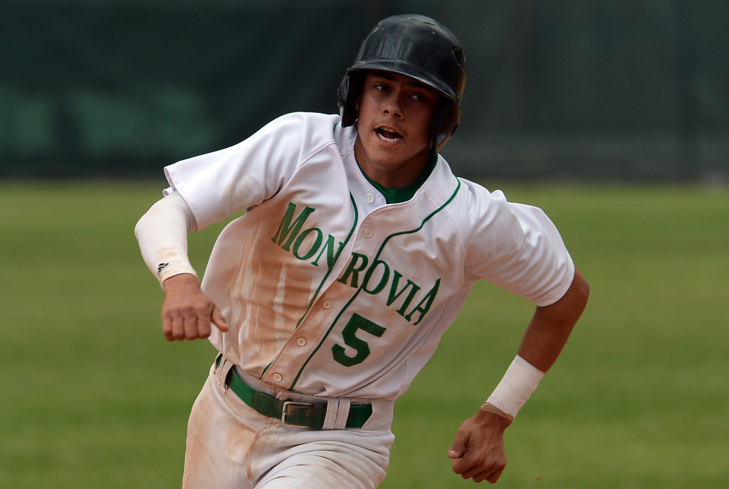. Monrovia\'s James Wright scores on a double by Nick Garcia (not pictured) against Whittier Christian in the first inning of a prep playoff baseball game at Monrovia High School in Monrovia, Calif., on Thursday, May 21, 2015. Monrovia won 6-1.  (Photo by Keith Birmingham/ Pasadena Star-News)