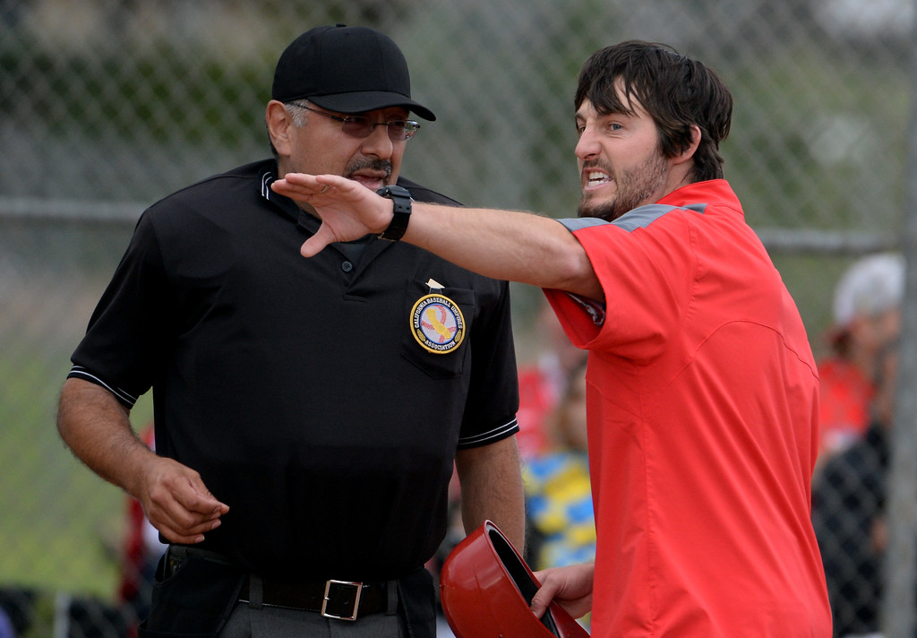 . Whittier Christian head coach Brent Lavoie argues with the home plate umpire over a double down the line by Juan Quinonez (not pictured) in the fourth inning of a prep playoff baseball game at Monrovia High School in Monrovia, Calif., on Thursday, May 21, 2015. Monrovia won 6-1.  (Photo by Keith Birmingham/ Pasadena Star-News)