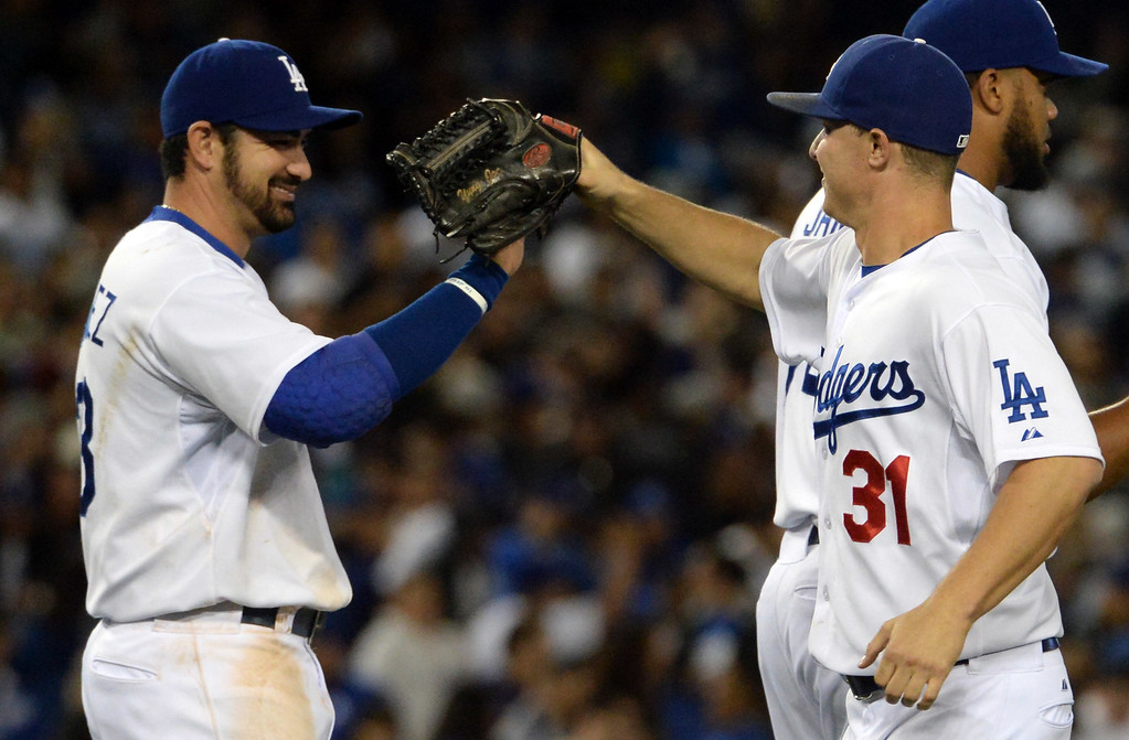 . Los Angeles Dodgers center fielder Joc Pederson (31) high fives first baseman Adrian Gonzalez (23) after defeating the San Diego Padres 2-1 during a Major League Baseball game on Friday, May 22, 2015 in Los Angeles.  (Photo by Keith Birmingham/ Pasadena Star-News)