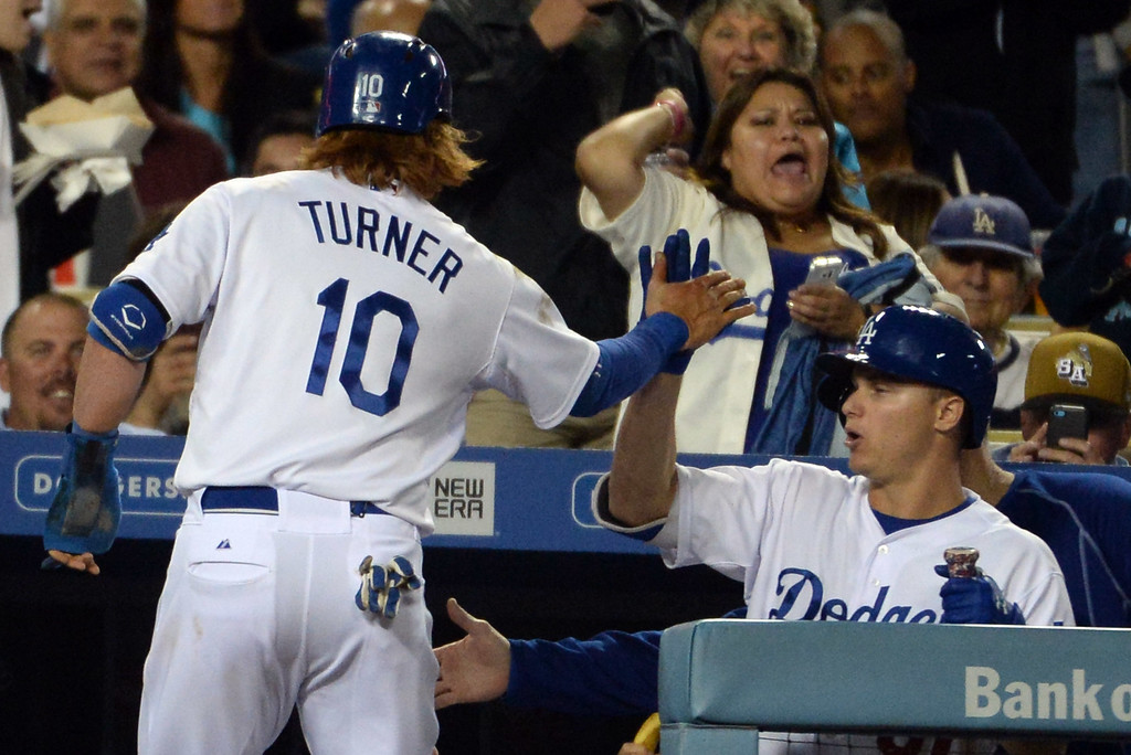 . Los Angeles Dodgers\' Justin Turner scores on a Andre Ethier (not pictured) single in the fifth inning of a Major League Baseball game against the San Diego Padres on Friday, May 22, 2015 in Los Angeles.  (Photo by Keith Birmingham/ Pasadena Star-News)