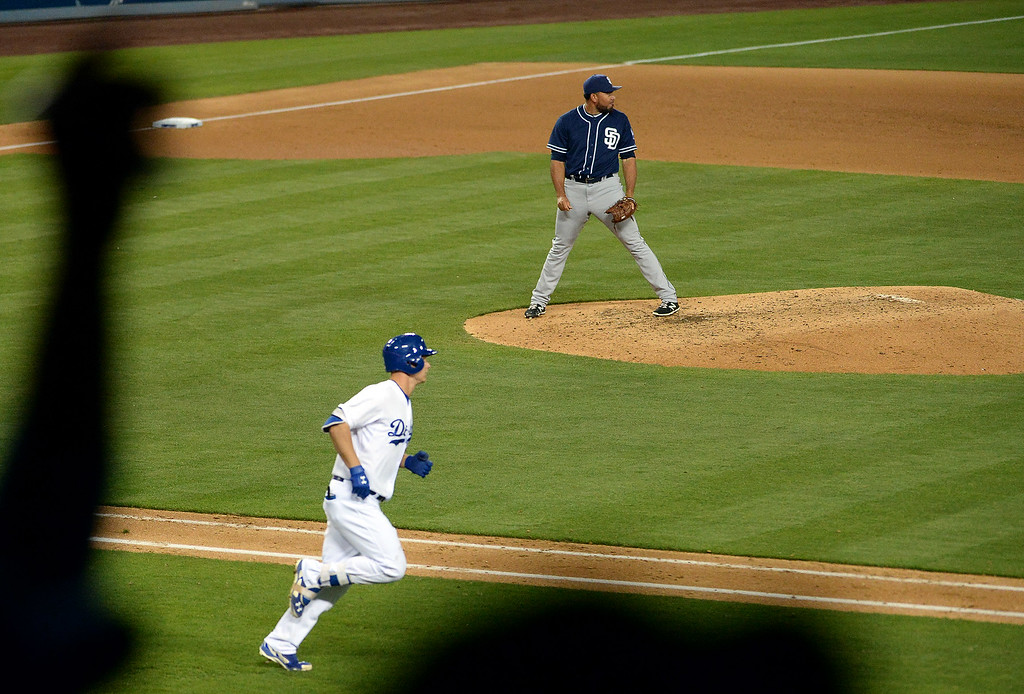 . Los Angeles Dodgers\' Joc Pederson watches his solo home run along with San Diego Padres relief pitcher Joaquin Benoit in the eighth inning of a Major League Baseball game on Friday, May 22, 2015 in Los Angeles.  (Photo by Keith Birmingham/ Pasadena Star-News)