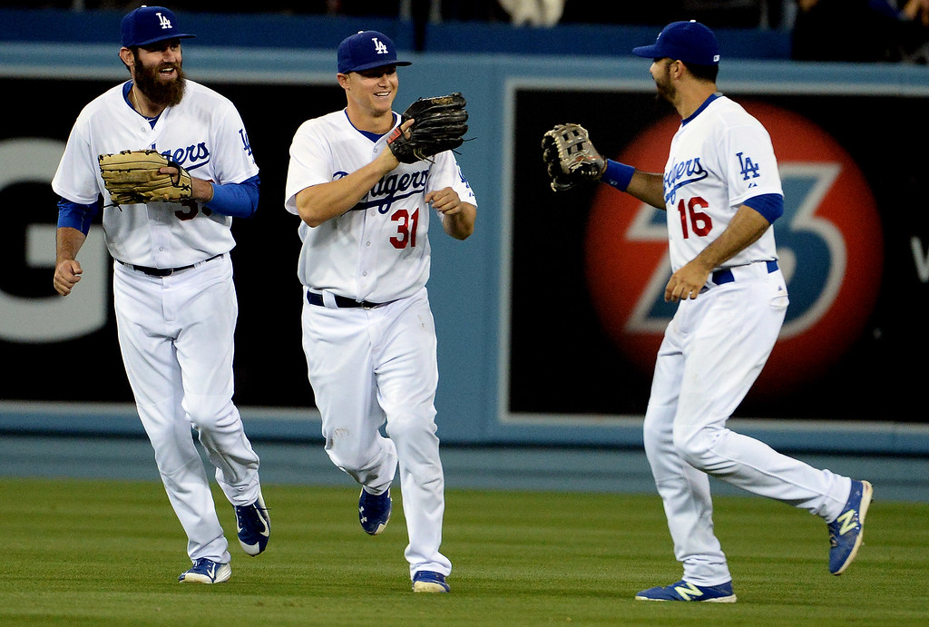 . Los Angeles Dodgers center fielder Joc Pederson (31) reacts with left fielder Scott Van Slyke, left, and right fielder Andre Ethier (16) after defeating the San Diego Padres 2-1 during a Major League Baseball game on Friday, May 22, 2015 in Los Angeles.  (Photo by Keith Birmingham/ Pasadena Star-News)