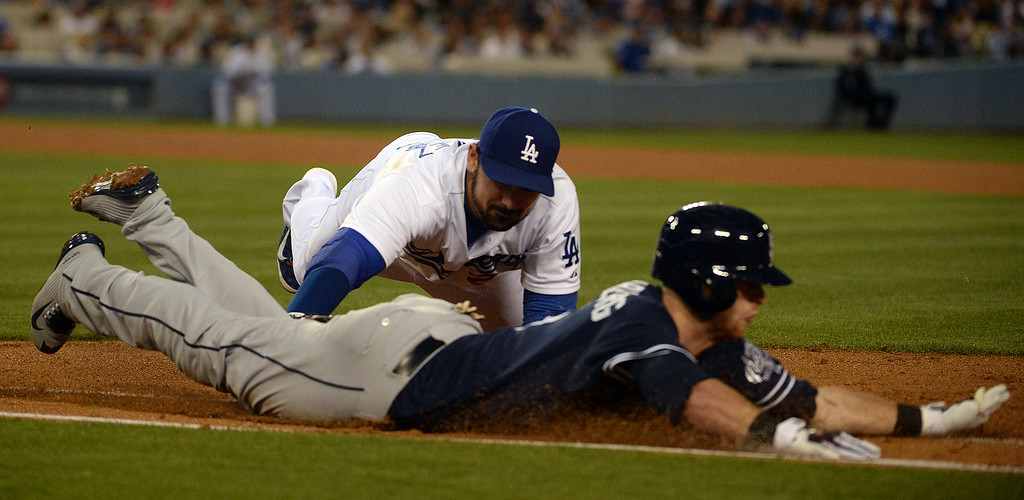 . Los Angeles Dodgers first baseman Adrian Gonzalez dives and tags out a diving San Diego Padres\' Cory Spangenberg at first base in the fourth inning of a Major League Baseball game on Friday, May 22, 2015 in Los Angeles.  (Photo by Keith Birmingham/ Pasadena Star-News)