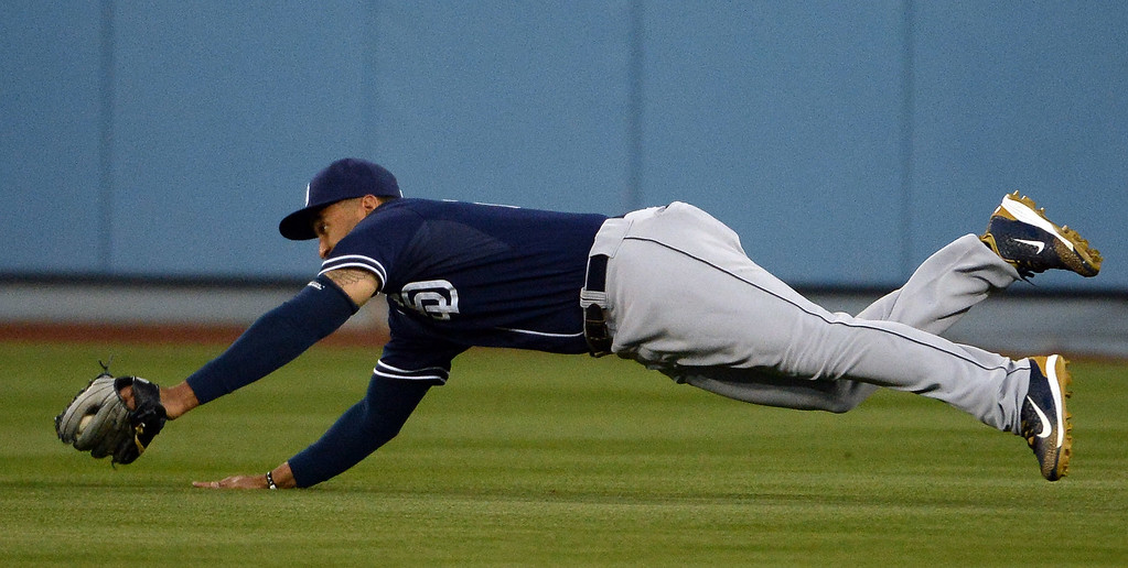 . San Diego Padres right fielder Matt Kemp makes a diving catch on a Los Angeles Dodgers\' Jimmy Rollins (not pictured) drive in the third inning of a Major League Baseball game on Friday, May 22, 2015 in Los Angeles.  (Photo by Keith Birmingham/ Pasadena Star-News)