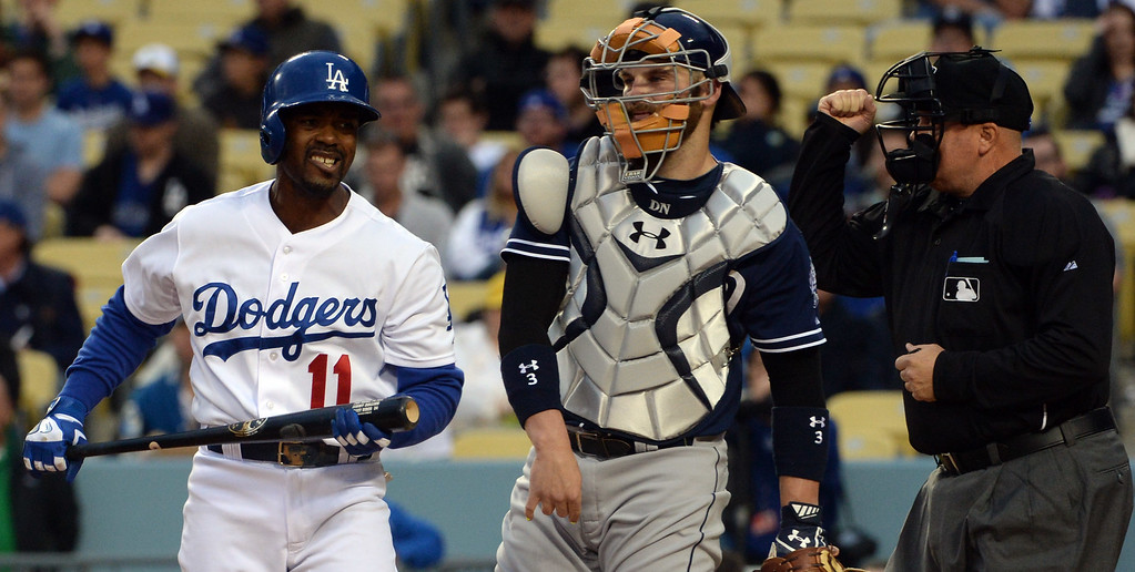 . Los Angeles Dodgers\' Jimmy Rollins (11) reacts after striking out swing as San Diego Padres catcher Derek Norris looks on as home plate umpire Brian O\'Nora makes the call in the first inning of a Major League Baseball game on Friday, May 22, 2015 in Los Angeles.  (Photo by Keith Birmingham/ Pasadena Star-News)