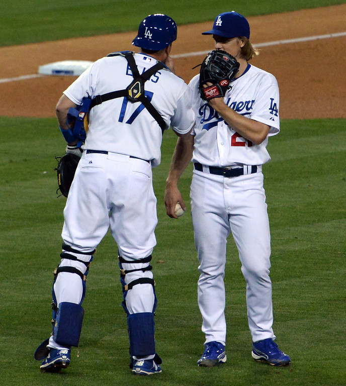. Los Angeles Dodgers starting pitcher Zack Greinke talks with catcher A.J. Ellis (17) against the San Diego Padres in the eighth inning of a Major League Baseball game on Friday, May 22, 2015 in Los Angeles.  (Photo by Keith Birmingham/ Pasadena Star-News)