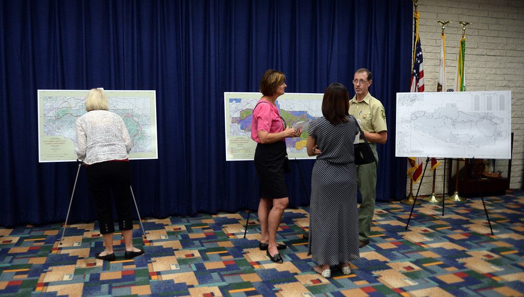 . Locals look over maps and discuss the monument during a open house about the San Gabriel Mountains National Monument where locals can talk to representatives, look over maps, displays and comment on what needs to improve at the Glendora Public Library in Glendora, Calif., on Wednesday, June 24, 2015. (Photo by Keith Birmingham/ Pasadena Star-News)
