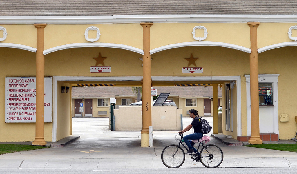 . A bicyclist rides past the Colonial Motel on Pacific Coast Highway in Long Beach CA Wednesday October 2, 2013. (Photo by Thomas R. Cordova/ Daily Breeze)