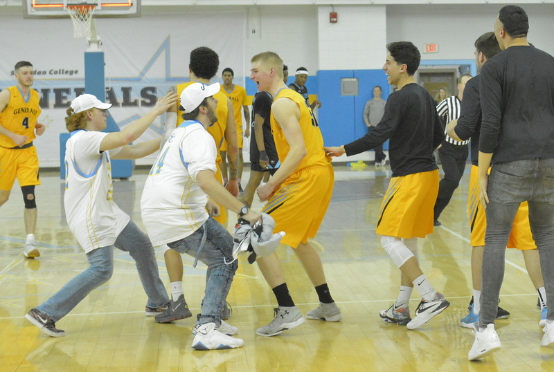 Justin Sheely | The Sheridan Press<br /> <br /> Fans rush the Generals team at the end of the game at the Bruce Hoffman Golden Dome Saturday, Feb. 17, 2018. The Generals beat the Pronghorns 85-70.