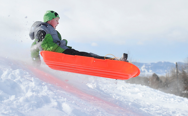 Justin Sheely | The Sheridan Press<br /> Eleven-year-old Jacob Alicke gets some air under his sled at Linden Hill Saturday, Feb. 24, 2018.