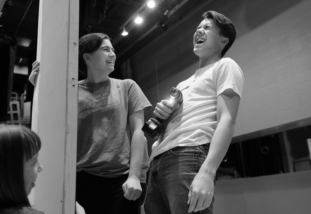 "Justin Sheely | The Sheridan Press<br /> <br /> Seniors Ashley Phillips, left, and Thomas Detmer react after dropping a screw during set construction at Sheridan High School Saturday, Feb. 17, 2018. The musical performance of ""The Boyfriend,"" directed by Stephanie ZuKowski, will show in the Sue Henry Auditorium at Sheridan High School March 1 – 3 at 7:30 p.m. and Sunday, March 4 at 2 p.m."