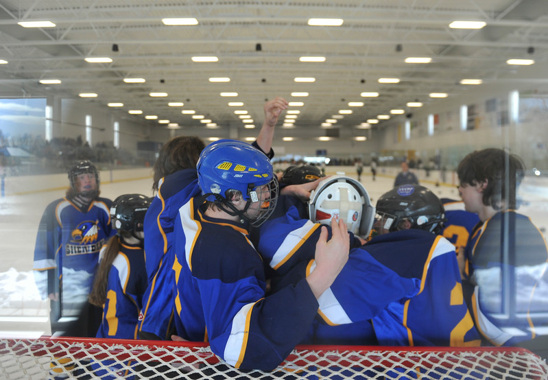 Justin Sheely | The Sheridan Press<br /> The Hawks swarm their goal keeper Josh Eaton after beating Laramie during the WAHL High School B State Championship at Whitney Ice Rink in the M&M's Center Sunday, Feb. 25, 2018. The Hawks beat Laramie 4-3 to claim their first state title in 12 years.