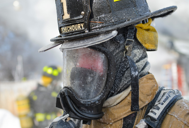 Justin Sheely | The Sheridan Press<br /> <br /> Sheridan Fire-Rescue firefighter Jason Etchechoury returns to the fire engine to swap out his oxygen pack during a structure fire on Coffeen Avenue Wednesday, Feb. 20, 2018. Sheridan Fire-Rescue, Goose Valley Volunteer Fire Department and Rocky Mountain Ambulance responded to a structure fire call at 9:58 a.m. Wednesday at 5461 Coffeen Ave.