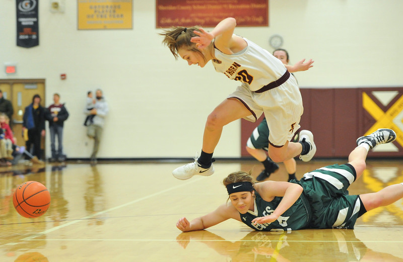 Justin Sheely | The Sheridan Press<br /> <br /> Big Horn's Courtney Wallach, top, avoids Tongue River's Brittany Fillingham at Big Horn High School Friday, Feb. 9, 2018. Big Horn Lady Rams won 47-28.