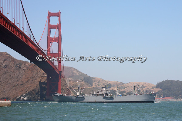 """SS Jeremiah O'Brien"", liberty ship, cruising under the Golden Gate Bridge.  She is 441 feet long."