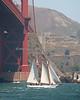 """""""Brigadoon"""", a gaff rigged schooner, sailing under the Golden Gate Bridge."""