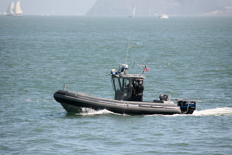 Marin Sheriff, patrolling the waters in the San Francisco Bay, in their 24 foot Almar Rigid Hull Inflatable boat powered by twin 150 HP Mercury Optimax outboard engines.