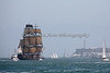 """HMS Bounty"" sailing off toward Alcatraz Island in the San Francisco Bay.  It's a rare sight to see a wooden, square rigger in full sail."