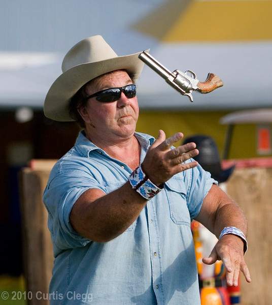 World-champion gun twirler Bob Hamm demonstrates his legendary skills during the Boone County Fair on Wednesday, August 11, 2010.