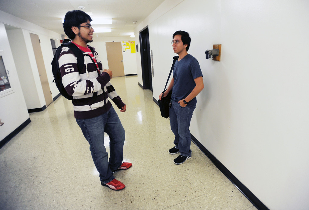 . Long Beach, Calif., -- 08-26-13- Carlos Vergara, a CSULB freshman and president�s scholar and aerospace engineering major,to a friend  his calculus class, Monday morning.  Monday is the start of classes for students at CSULB.        Stephen Carr/  Los Angeles Newspaper Group