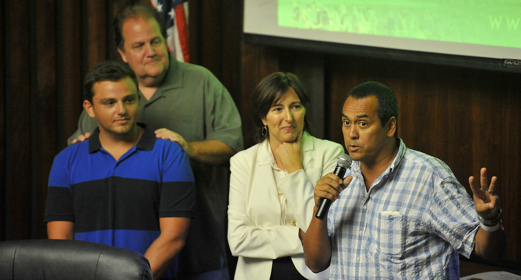 . Shark attack victim Steven Robles, right, thanks Ryan Silver, far left, who helped save him from the water, before the Manhattan Beach City Council heard public comment about the possible ban on fishing off the pier after the recent shark attack, in Manhattan Beach, CA. on Tuesday July 15, 2014. (Photo by Sean Hiller/ Daily Breeze). Mayor Amy Howorth listens Robles share his story.