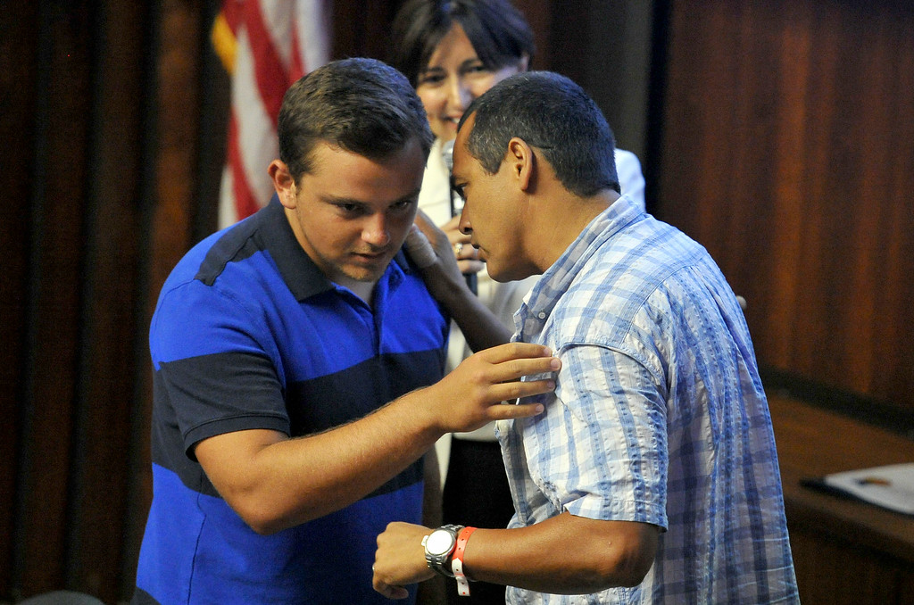 . Shark attack victim Steven Robles, right, thanks Ryan Silver, who helped save him from the water, before the Manhattan Beach City Council heard public comment about the possible ban on fishing off the pier after the recent shark attack, in Manhattan Beach, CA. on Tuesday July 15, 2014. (Photo by Sean Hiller/ Daily Breeze).