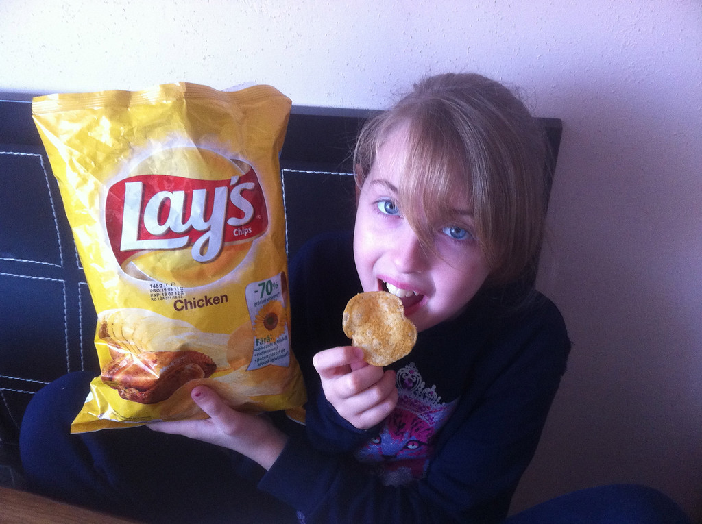 """Yes, you read it correctly. It says """"Chicken"""" flavor. The chips smell and taste like chicken. Lauren loves them."""