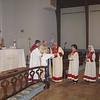 Fr. Daniel Findikyan administers Holy Communion.