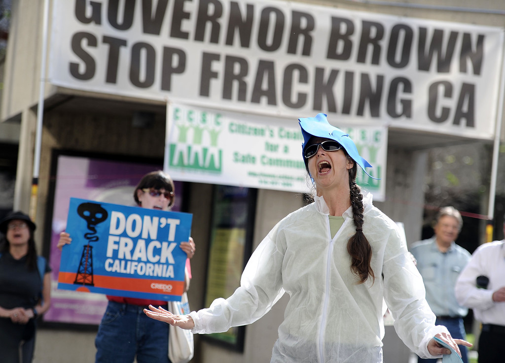 ". Andrea Weber, with the Center for Biological Diversity leads environmentalists a demonstration to protest ""fracking\"" outside the Coastal Commission\'s meeting at Long Beach City Hall in Long Beach, CA. on Wednesday March 12, 2014. (Photo by Sean Hiller/ Daily Breeze)."