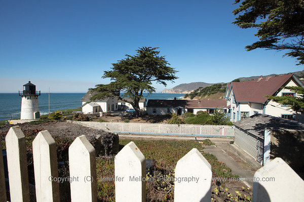 Peeking over Fence at Point Montara Lighthouse and Hostel
