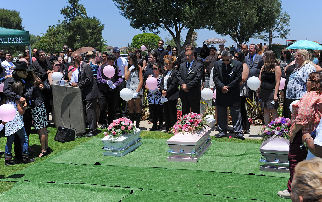 . Funeral services for three Coronado children, Xenia, 2 mo., Yazmine, 16 mo. and Sophia, 2. 5 yrs. Rudy Coronado, father, at far left with family members.  Green Hills Memorial Park in Rancho Palos Verdes.    (June 2, 2014 Photo by Brad Graverson/The Daily Breeze)