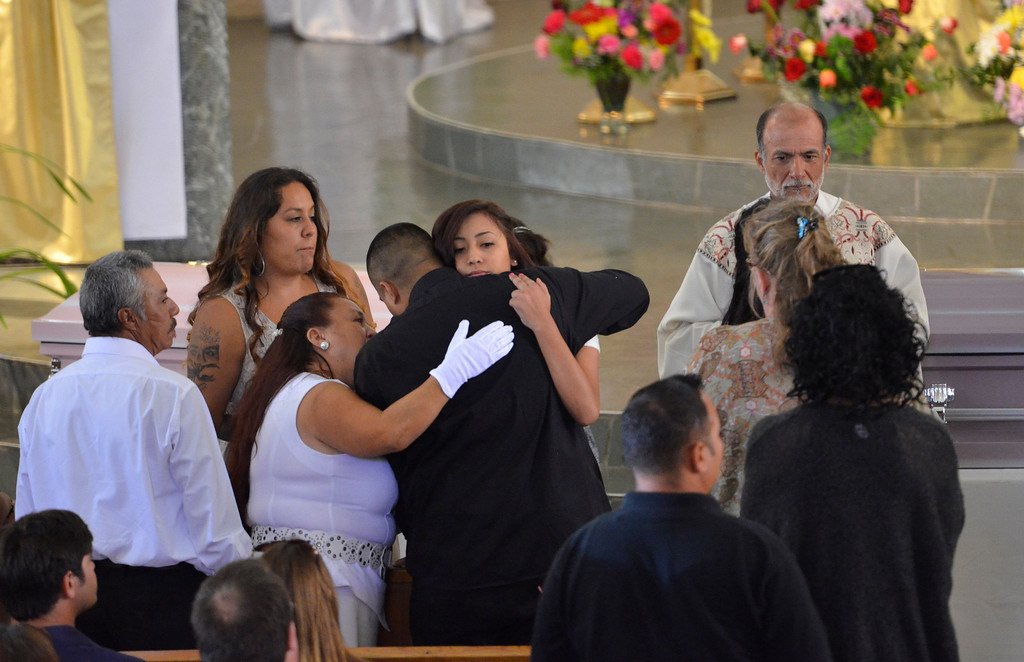 . Rudy Coronado comforted by family at funeral services for three murdered Coronado children from the Carson area. Rudy Coronado, father, at St. Anthony of Padua Church in Gardena.   (June 2, 2014 Photo by Brad Graverson/The Daily Breeze)