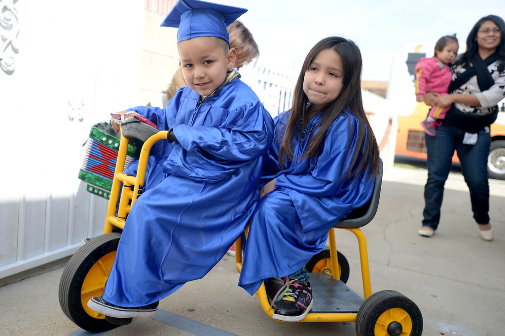 . Isaiah Miranda,4, and sister Victoria, 6, cruise around at the  �Gapbusters� Child Care Bus Tour visit at Ramona�s Day Care in Long Beach, CA. on Tuesday, February 18, 2014. (Photo by Sean Hiller/ Daily Breeze).