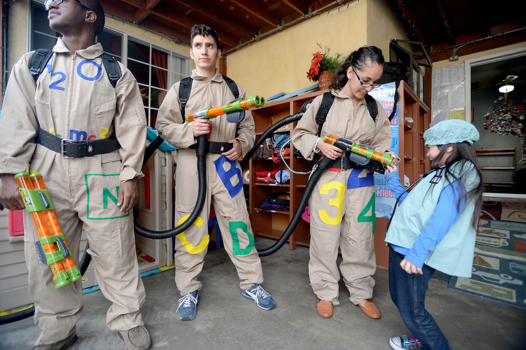 . Pearla Castellanas, dressed as a nurse, 5 checks out �Gapbusters �  lladira Baez, right, Dario Valles, center, and Shola Ajayi during the Child Care Bus Tour that stopped by Ramona�s Day Care to see firsthand the quality program going on inside provider Ramona Duran�s home in Long Beach, CA. on Tuesday, February 18, 2014. (Photo by Sean Hiller/ Daily Breeze).