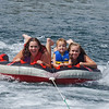 Lindsey, Cameron, and Joelene at 16mph, the fastest for Cameron. He also went outside the boat wake for the first time ever. I normally tow the tube between 22 and 23 mph.