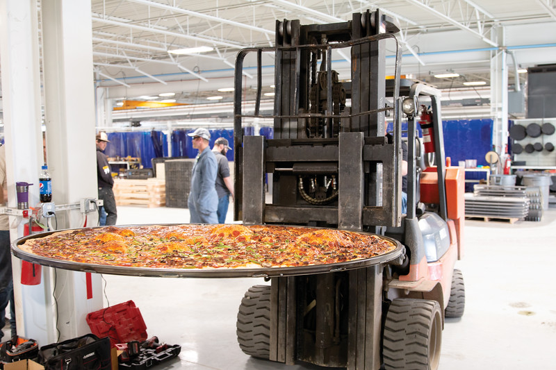 Matthew Gaston   The Sheridan Press<br>The super pizza is removed from the. powder coat oven via forklift after just over 35 minutes baking at EMIT Technologies Friday, March 22, 2019.