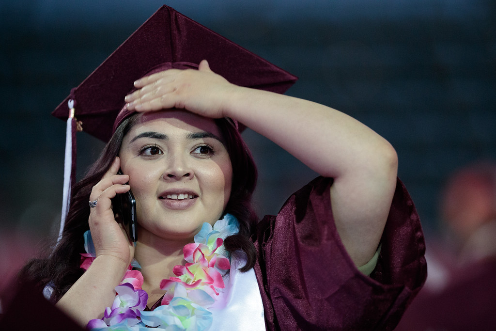 . A graduate searches the crowd for her guest during the Mt. San Antonio College 2017 Commencement Ceremony at the Citizens Business Bank Arena in Ontario, Calif., on Sunday June 18, 2017. (Photo by Raul Romero Jr, SCNG)