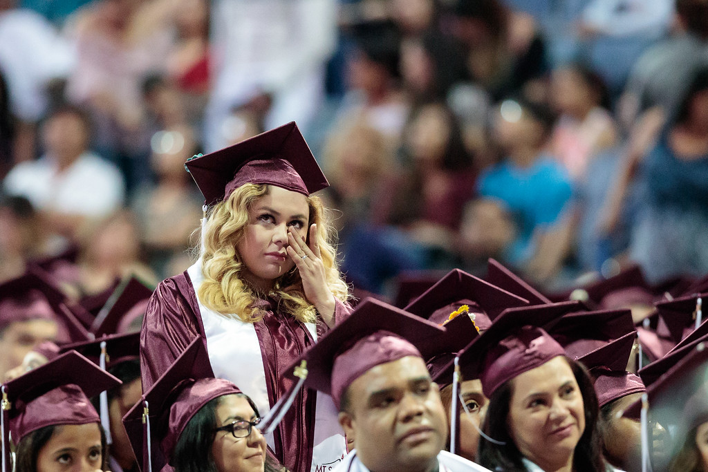 . A graduate wipes her tears after being acknowledged as one of ten students of distinction during the Mt. San Antonio College 2017 Commencement Ceremony at the Citizens Business Bank Arena in Ontario, Calif., on Sunday June 18, 2017. (Photo by Raul Romero Jr, SCNG)