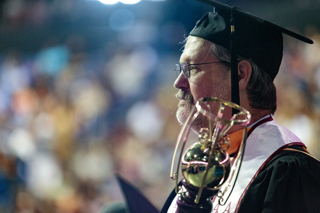 . A faculty member holding an academic mase looks on as students enter the venue during the Mt. San Antonio College 2017 Commencement Ceremony at the Citizens Business Bank Arena in Ontario, Calif., on Sunday June 18, 2017. (Photo by Raul Romero Jr, SCNG)