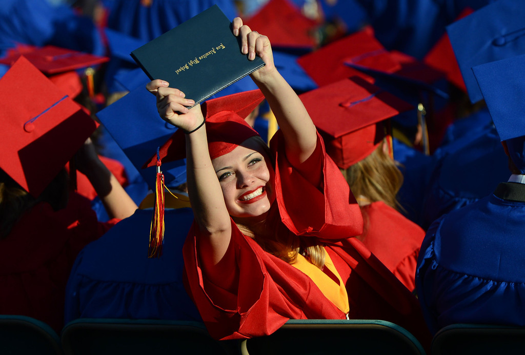 . Los Alamitos High School graduates Holly Tinturin shows off her diploma to members of her family,  during The Los Alamitos Commencement Exercise, at the StubHub Center in Carson Calif.,  Thursday evening.   Long Beach Calif., Wednesday June12,  2014.     (Photo by Stephen Carr / Daily Breeze)