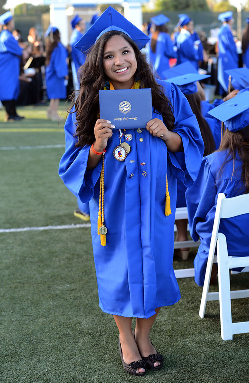 . Warren graduate Gabrielle Villa celebrates after receiving her diploma during the Warren High School Commencement Ceremony.  Long Beach Calif., Thursday June19,  2014.     (Photo by Stephen Carr / Daily Breeze)