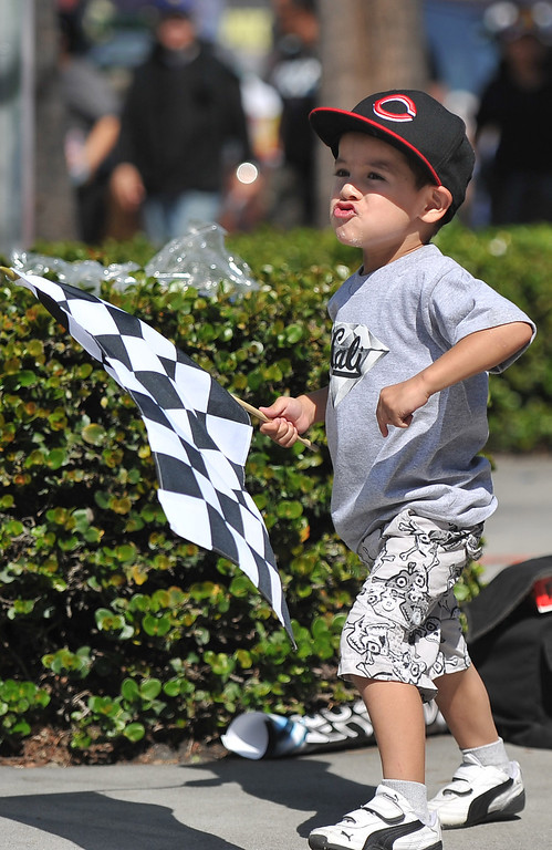 . Jeremy Juarez dancing with his flag  at the Toyota Grand Prix of Long Beach. Long Beach April 12, 2014. (Photo by Brittany Murray / Daily Breeze)