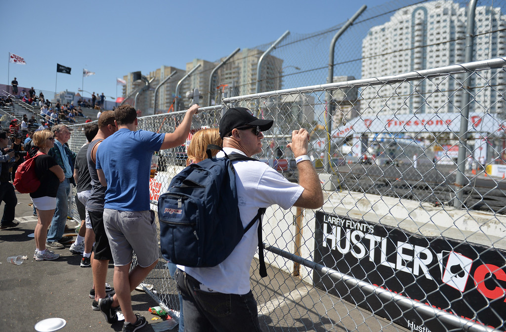 . Fans enjoy the action around the track at the Toyota Grand Prix of Long Beach. Long Beach April 12, 2014. (Photo by Brittany Murray / Daily Breeze)