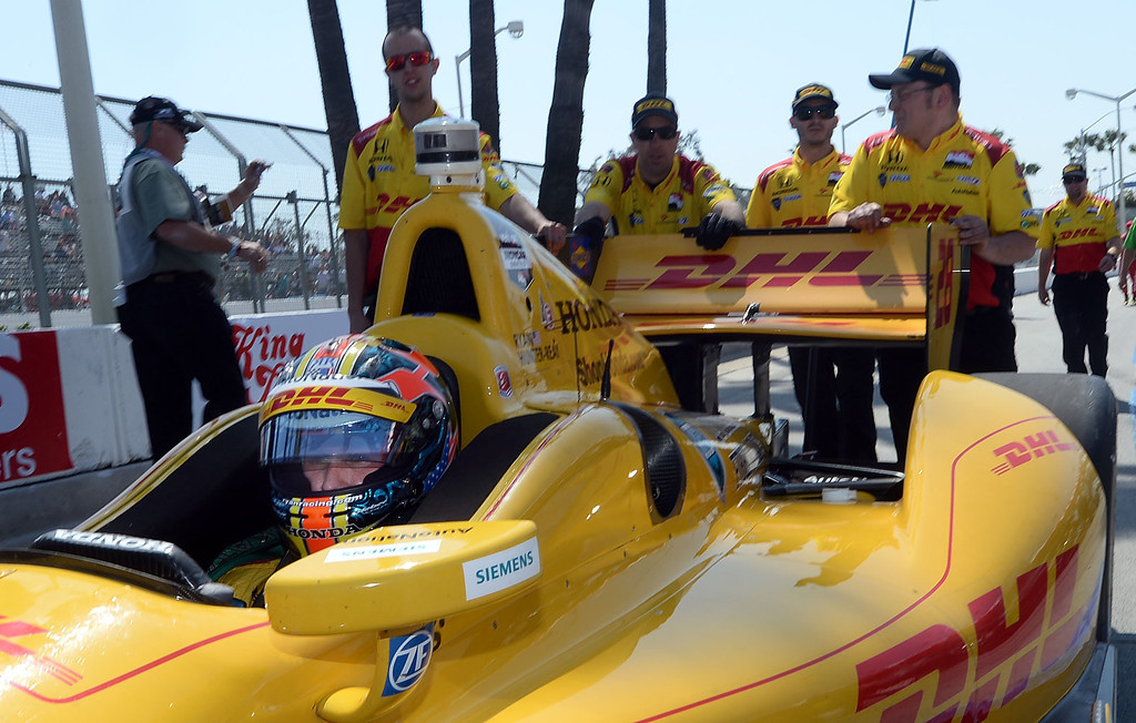 . Indycar driver Ryan Hunter-Reay is pushed to a staging area after winning the pole Saturday April 12, 2014 for Sunday\'s 40th Toyota Grand Prix of Long Beach.  (Will Lester/Inland Valley Daily Bulletin)