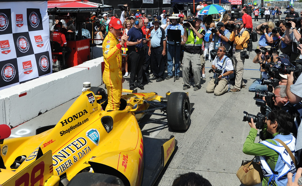 . IndyCar driver Ryan Hunter -Reay  celebrates after winning the IndyCar Qualifying & Firestone Fast 6 Saturday, at the 40th Annual Toyota Grand Prix of Long Beach.       Long Beach Calif., Saturday, April 12,  2014.   (Photo by Stephen Carr / Daily Breeze)