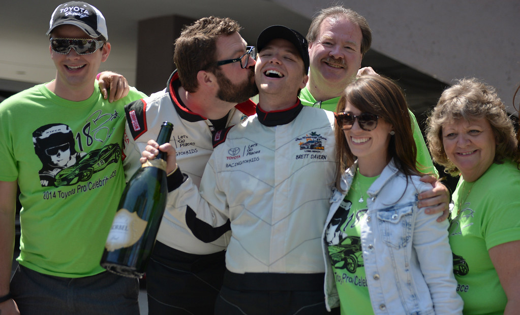 . Toyota Grand Prix of Long Beach Pro/Celeb Race winner Brett Davern  with Rutledge Wood and family after the race. Long Beach April 12, 2014. (Photo by Brittany Murray / Daily Breeze)