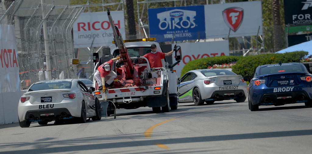 . Corbin Bleu is towed off the track after a crashe on turn 1during the Pro Celebrity Race at the 40th Annual Toyota Grand Prix of Long Beach in Long Beach, CA. on Saturday April 12, 2014. (Photo by Sean Hiller/ Daily Breeze).