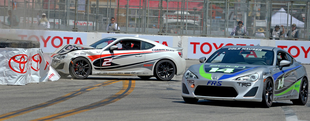 . Corbin Bleu crashes on turn 1during the Pro Celebrity Race at the 40th Annual Toyota Grand Prix of Long Beach in Long Beach, CA. on Saturday April 12, 2014. (Photo by Sean Hiller/ Daily Breeze).