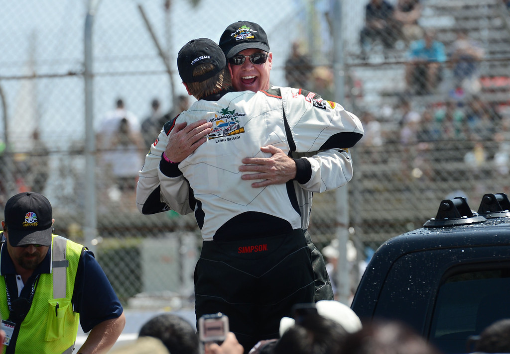 . Actor Brett Davern, left, and pro driver Al Unser Jr. celebrate after the two won the Toyota Pro / Celebrity Race Saturday, at the 40th Annual Toyota Grand Prix of Long Beach.   	    Long Beach Calif., Saturday, April 12,  2014.   (Photo by Stephen Carr / Daily Breeze)